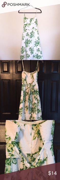 Forever 21 White and Green Floral Dress Forever 21 Floral Tie-Back Dress | Swiss Dot fabric | some green has run around the flowers (purchased like this; barely noticeable) | size L | knee length | back zip | bow ties in back  •Lowball offers declined •no trades •ask all questions before buying •unfair ratings from buyers are reported & buyer will be blocked - I don't misrepresent my products; what you see is exactly what you get & my prices are way more than fair. Please be kind as I always…