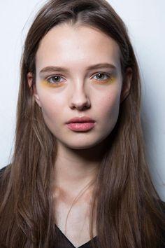 Under Eye Liner is Trending at NYFW - Derek Lam yellow eyeshadow makeup look backstage
