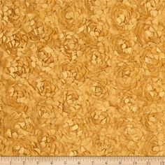 Starlight Meyammy Flower Satin Gold from   This fabulous fabric features elegant satin ribbon sewn to lightweight satin fabric, forming intricate rosettes throughout. Both selvedges feature plain satin 2'' wide vertical borders. Voluminous and dimensional, this fabric is perfect for home décor accents like  tabletop or fancier duvet covers and pillow covers, as well as special occasion apparel dresses, skirts, and capelets.
