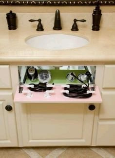 The fake drawer thts in the cabinet can be reused to put ur hair dryer, curling iron, n etc.