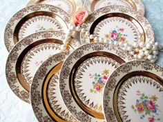 Gorgeous vintage Homer Laughlin little plates! Gold and cream with brilliant flowers in pink, yellow, and blue!  Set of eight plates, diameter 6 1/4 - perfect as small dessert plates or bread and butter plates! Marked HL, eggshell, nautilus, usa, M45N5. No chips or cracks, some light scratches, light wear.  More beautiful vintage small plates here: https://www.etsy.com/shop/thechinagirl?section_id=6787987&ref=shopsection_leftnav_2  Your order will be wrapped with pretty tissue paper…