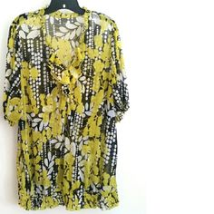 "Lane Bryant 26/28 Yellow & Black Floral Print Top This Lane Bryant 26/28 Yellow & Black Floral Print Top is in good used condition. The fabric is 100% polyester  with stretch and is semi-sheer, best with a cami. There are a few minor snags upon very close inspection, but not easily noticeable. Bust: 26"" across laying flat, measured from pit to pit, so 52"" around unstretched. 31"" long. ::: Bundle 3+ items from my closet and save 30% off when you use the app's Bundle feature! ::: No trades…"