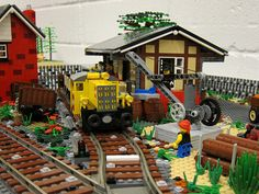 A close-up shot of my freight shed with the loading crane. Lego Train Station, Lego Crane, Lego Boards, Cool Lego Creations, Lego Projects, Lego Stuff, Lego Moc, Lego Technic, Train Layouts