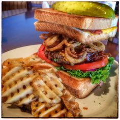 Texas Beast Burger (1/2lb burger topped with American cheese, crispy onion rings, BBQ bacon sauce, lettuce, tomato in between 2 sets of bacon grill cheese sandwiches