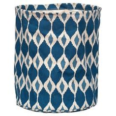 """Cotton canvas basket in navy with a diamond ikat motif.  Product: BasketConstruction Material: Cotton canvasColor: NavyFeatures:  Collapsible for easy storageWater-resistant lining Dimensions: 13"""" H x 12"""" Diameter"""