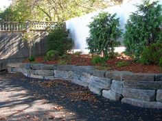 "Bluestone Retaining Walls | Fundy Bluestone"" armour stone retaining wall."