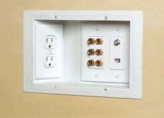 Use recessed outlets. This way you can put your furniture against the wall and plugs don't get in the way.