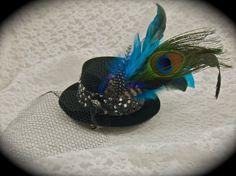 Mini Top Hat Fascinator Clip  RAZZLE DAZZLE  by LoveJoyAdornments, $35.00  https://www.etsy.com/listing/89225352/mini-top-hat-fascinator-clip-razzle?ref=usr_faveitems
