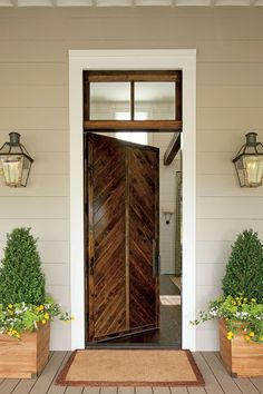 Nashville Idea House Tour | The chevron design of the wood door dates back centuries. Besides looking great, it's also a practical choice. The pattern keeps the door stable and sheds water to prevent warping. #homeideas #southernliving #curbappeal #porchdecor