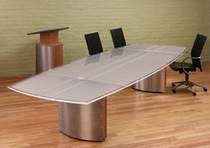 White Glass top Conference tables and contemporary Boardroom furniture with wiring grommets and Stainless Steel bases. Hand-built to order in the USA.