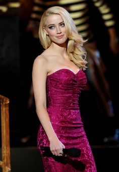 The beautiful Amber Heard Trendy Fashion...  She next starred as Shay in Side FX (2005), an independent horror film, and had supporting roles in Drop Dead Sexy (2005), Price to Pay (2006) and You Are Here (2006).
