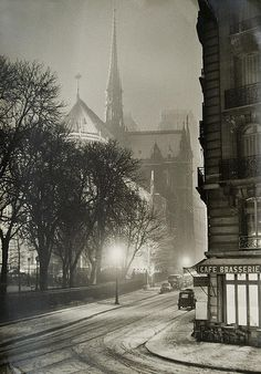 Notre Dame, Paris in the winter, at night, c. 1940s