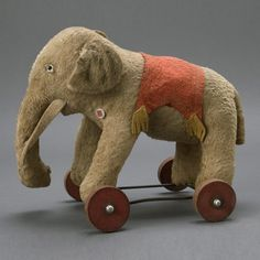 335: Steiff Elephant Toy on Wood Wheels, circa 1940 : Lot 335