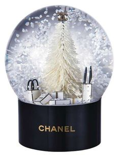 WHAT CHANEL DREAMS ARE MADE OF. Treat yourself or someone special to this Outstanding piece, Chanel is forever. With a little shake to the globe these luscious little white flakes float around, it is just the. Christmas Snow Globes, Pink Christmas, Merry Christmas, Christmas Ecard, Vintage Chanel, Gabrielle Bonheur Chanel, Chanel Price, Mademoiselle Coco Chanel, Color Borgoña