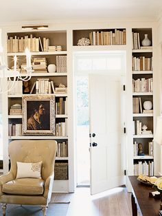 Loi=uisiana shot gun house interior | Floor-to-ceiling bookcases add a sense of history and accentuate the ...