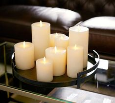 With a hint of Art Deco design, our rustic tray is an artistic piece for a grouping of pillars and votives – and a few natural objects for added drama. Candle Centerpieces For Home, Candle Arrangements, Candle Tray, Candle Lamp, Flameless Candles, Candle Wall Sconces, Votive Candles, White Candles, Coffee Table Candle Decor