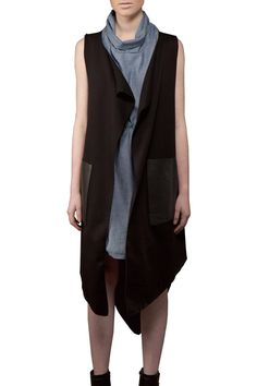"""Thisvest is great for every season; it featuresa rounded hem at the bottom thatthrow it over a tank and jeans or pair it with the white Brenda Swing Shirt and a high-heeled boot.  measures 44"""" at the front from shoulder and 48.5"""" at the back. One size fits most.  Black Sophie Vest by Lennard Taylor. Clothing - Jackets Coats & Blazers - Vests Canada"""