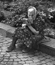 """This will be me in 20 years.  """"I'm tired pulling weeds.  Guess I'll just get this book out of my pocket and read.""""  No kidding!  (No dress & stockings, though.)"""