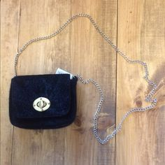 Fur purse ✨✨Host pick!✨✨ This fun black purse is perfect to keep your things in for a night out! Has a cross body chain. Brand new! Bags