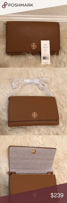 NWT Tory Burch Robinson Leather Chain Wallet NWT Tory Burch Robinson Chain Wallet  Style No: 31159004 Color/material: Tigers Eye Exterior design: gold tone hardware, back compartment Interior design: zippered center compartments, bill slots, multiple card slots, fabric lining Measurements: 7.5in wide x 4.75in high x 1.25in deep Removable shoulder strap drops 22.5in Fold-over flap with snap closure Tory Burch Bags Crossbody Bags