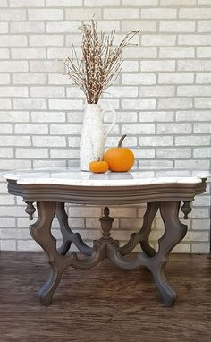 Burlington Vintage & Co. Painted the base of this beautiful coffee table with Hurricane Gray by Dixie Belle Paint Company! #dixiebellepaint #bestpaintonplanetearth #chalklife #homedecor #doityourself #diy #chalkmineralpaint #chalkpainted #easypeasypaint #makingoldnew #whybuynew #justpainting
