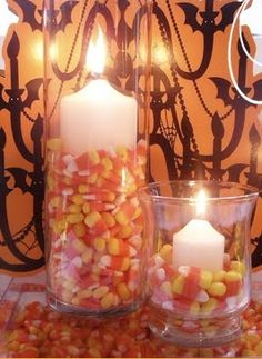 Love the idea of filling up the glass with candy corn. They have an LED candle at Hobby Lobby on clearance that's white with a black scrolly design and an L on it. Hmmmm....looks like Ill be hitting the HobLob today. Safety first!