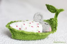 Crocheted mouse in a little leaf boat bed