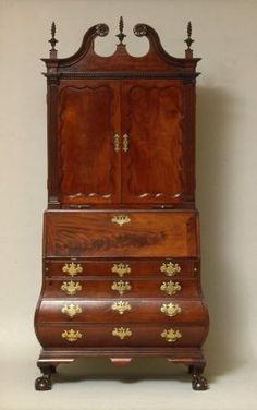 Desk and bookcase, bombé base ca 1760. MFA Boston.