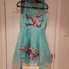 NWT Medium, knee length dress Beautiful embroidery, light teal. The dress has pockets! Never worn. Dresses Midi