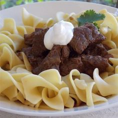 This Hungarian-style goulash is a thick beef stew served over buttered noodles…