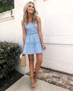cute gingham dress and straw bag for spring and summer