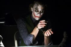 32 on-set photos of Christian Bale and Heath Ledger during the interrogation scene from THE DARK KNIGHT, accompanied with Christopher Nolan ...