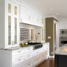 I love this funky inlay to create a hit of color and a focal point.  Love white kitchens.  LOVE.  Traditional kitchen by The Sky is the Limit Design