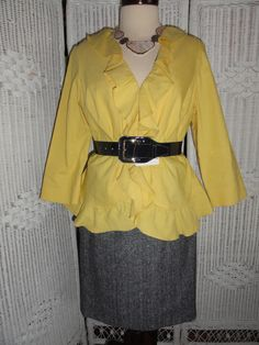 This is just one of the many ensembles that you can create with Doncaster's   8 GR8 Style Pieces.  Picture includes: Second Jacket, Suit Skirt, a necklace and belt. Two of the 3 key accessories for this 8 GR8 Style Pieces.