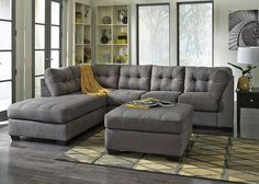 The Maier Sectional Sofa is a casual and contemporary piece of furniture perfect for your living room or family room use. Designed for homes that seek a soft and homey atmosphere, this collection features smooth pulled upholstery, comfortable seat cushions, small wood feet and button tufted back cushions. Multiple sectional configurations allow homeowners to create the arrangement that best suits their home. This collection makes a perfect casual contemporary addition to any home and ...