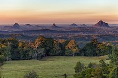 Glasshouse Mountains from Mary Cairncross Park, near Maleny. The highrise buildings of Brisbane can just be seen on the horizon in the middle of the frame. Visit Australia, Queensland Australia, Australia Travel, Glasshouse Mountains, Semarang, Sunshine Coast, Glass House, Stunning View, Beautiful