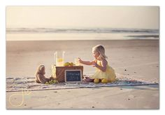 enjoying refreshments with her bff on the beach...precious!
