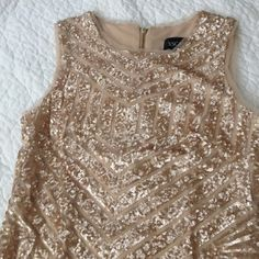 Sequin cocktail dress Beautiful rose gold sequin dress with geometric pattern. Form fitting, but very comfortable. Fully lined, with zipper down the back! In like new condition! Only worn once for a wedding. No rips, tears, or snags. Purchased at Dillard's, brand is Xscape. Dresses Mini