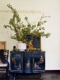 Fabulous! Gorgeous table top portrait, olive branches and more on a lacquer stand - elegant!