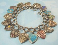 Antique Victorian sterling silver puffy heart and enamel Guilloche charm bracelet.