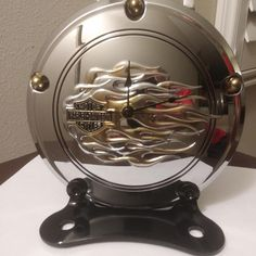 Another view of desk/mantle clock made from used Harley Davidson parts. SOLD