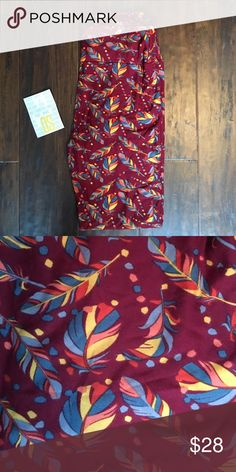 BNWT LuLaRoe Feather Leggings Wine background, softer then a lot of my other pairs too!!! LuLaRoe Pants Leggings