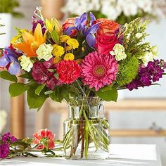 The colors or floral varieties used in this bouquet will vary based on freshness and availability. Our Florist Originals Bouquets are created by local florists using the finest quality flowers. The actual design you or your recipient will receive will be different from the images shown here.   Please Note: The photos here are examples of the 'Bold & Bright' style. The exact design and flowers will vary based on availability and the designer's interpretation of this arrangement. Wildflower Bridal Bouquets, Wildflower Centerpieces, Spring Wedding Bouquets, Flower Bouquet Wedding, Bright Wedding Flowers, Bright Flowers, Cut Flowers, Floral Wedding, Colorful Wedding Centerpieces