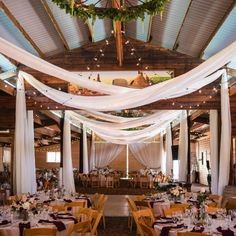 Barn wedding with drape fabric. Must have a very tall ladder. Wedding Draping, Wedding Stage, Wedding Venues, Barn Wedding Decorations, Table Decorations, Wedding Planning Websites, Indoor Wedding, Event Decor, Rustic Wedding