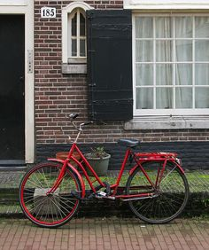 Red Bicycle In St. Andrieshofje, Amsterdam