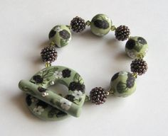 Hedgerow bracelet with polymer clay beads by LouiseGoodchild, Jewelry Crafts, Jewelry Bracelets, Jewellery, Polymer Clay Beads, Clay Tutorials, How To Make Beads, Handmade Items, Jewelry Making, Stud Earrings