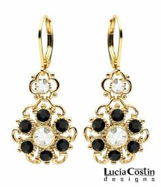 24K Yellow Gold Plated over .925 Sterling Silver Flower Shaped Dangle Earrings by Lucia Costin with Twisted Lines and Dots, Accented with Black and White Swarovski Crystals; Handmade in USA Lucia Costin. $54.00. Embellished with black and white Swarovski crystals. Lucia Costin dangle earrings. Delicate floral design. Unique and feminine, perfect to wear for special occasions and evenings. Produced delicately by hand, made in USA