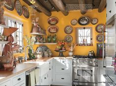 Rustic Style kitchen with Mango walls featured in House Beautiful.