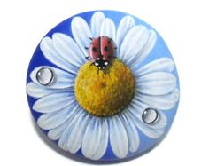 Red Ladybug and water drops on a white daisy hand painted on stone! A great handmade painted stone made by me! Is painted on a smooth sea stone which i have collected from a beach on a Greek island. Is painted with fine art quality acrylic colors and very small brushes for the detail , is signed on the back and covert with strong glossy varnish for protection. Dimensions approximately : Height : 6 cm ( 2.4 in ) Width : 7.3 cm ( 2.9 in ) Your art works will arrive carefully packaged. Recommen