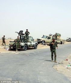 Kurdish Iraqi Peshmerga forces deploy their troops and armoured vehicles on the outskirts ...